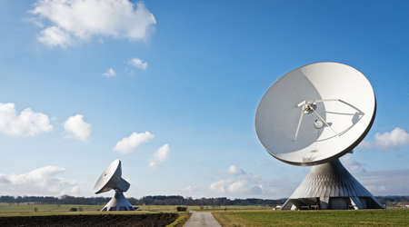satellite dishes at a meadow near munich - germany Stock Photo