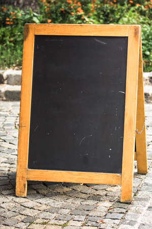 a bulletin board: empty black board (menu board) at a restaurant - nice backgroud with space for text