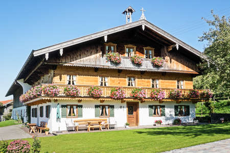 allgau: typical old farmhouse at the european alps Stock Photo