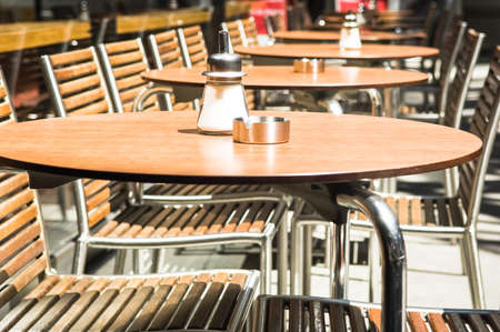 table and chairs at a cafe photo