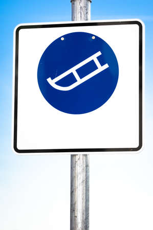 luger: luger warning sign in front of blue sky Stock Photo