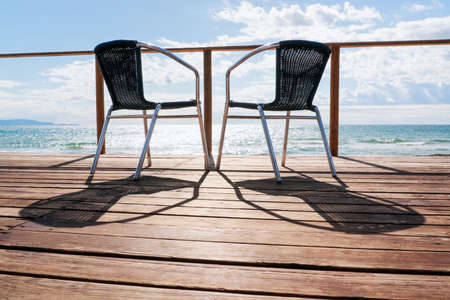 two chairs at a patio photo
