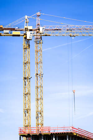 modern construction cranes in front of blue sky Stock Photo - 17376408