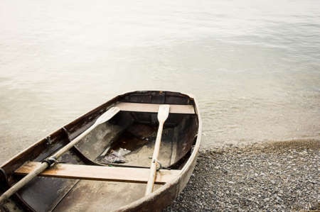 water's edge: old rowboat