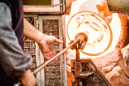 glass blower at a factory