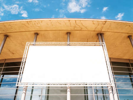 billboard posting: blank billboard at a modern building - nice background with space for text Stock Photo