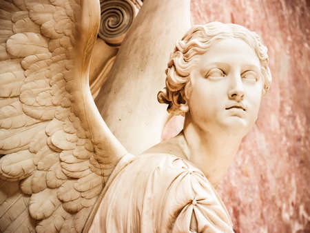 marbles close up: beautiful antique angel - close up