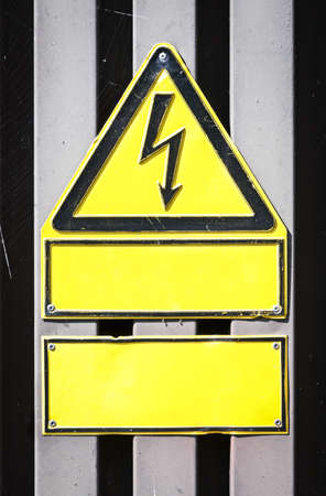 high voltage sign and blank signs with space for text photo