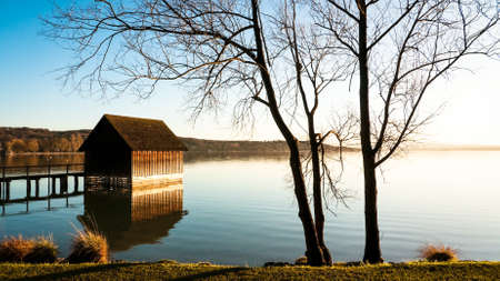 old wooden hut at a lake photo
