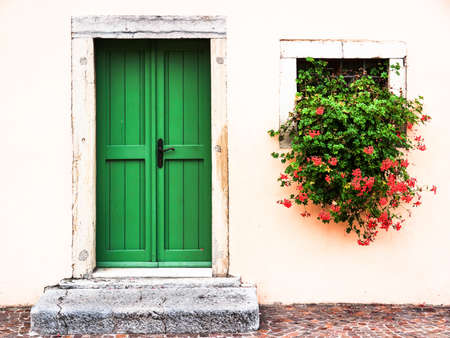 geranium color: old door at a historic building in italy Stock Photo