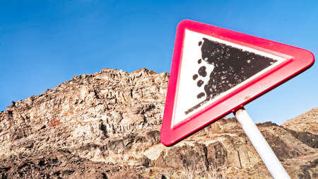 forewarning: rock slide sign - warning sign
