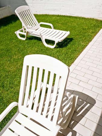 furniture part: modern sunlounger at a backyard