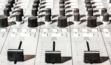 close-up of an old sound mixer panel photo