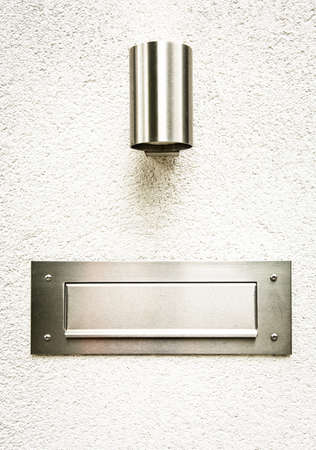 modern mail slot and lamp at a wall Stock Photo - 17743627