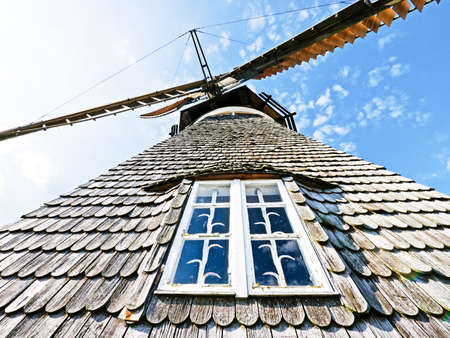 unusual angle: typical old windmill at the netherlands
