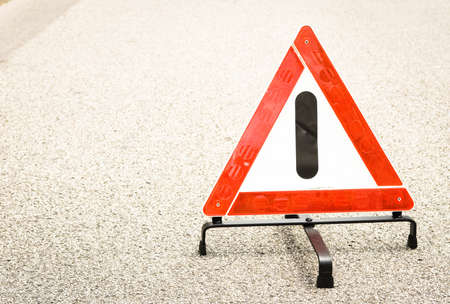 warning triangle at a street