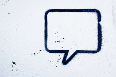 speech bubble at a wall - space for text photo