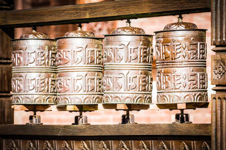 tibetan buddhism prayer wheels - close-up photo