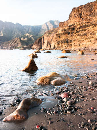 water's edge: cliff at the westside of gran canaria - porto de las nieves - agaete Stock Photo