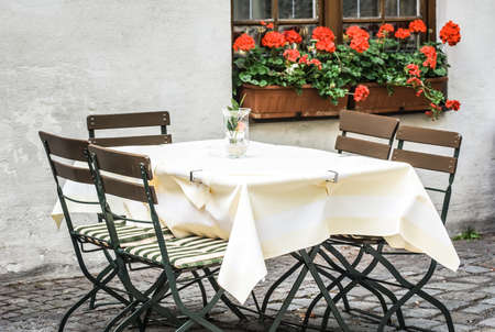 table at a sidewalk restaurant photo