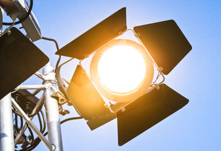 modern spotlight in front of blue sky photo