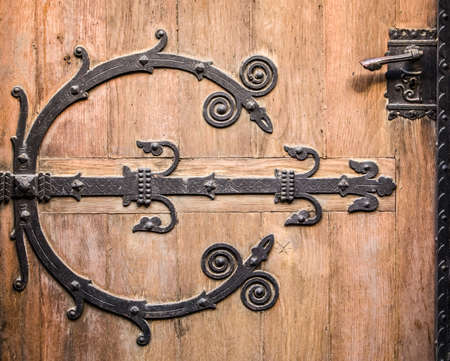 antique keyhole: close-up of an old wooden door
