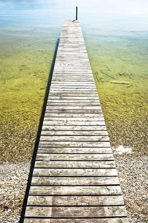 unusual angle: old wooden jetty at a lake Stock Photo