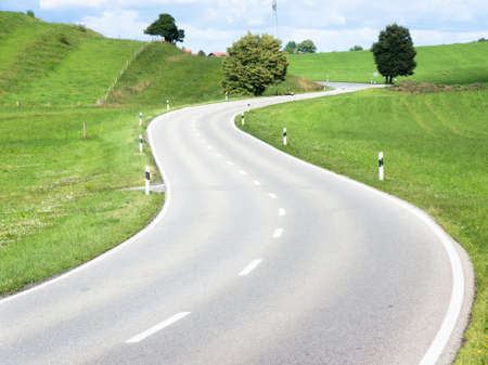 winding road: curve at the european alps
