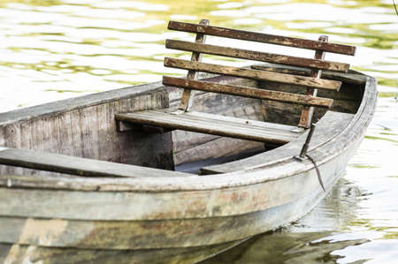 old wooden rowboat at a lake photo