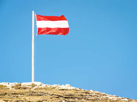 austrian flag at a mountain photo