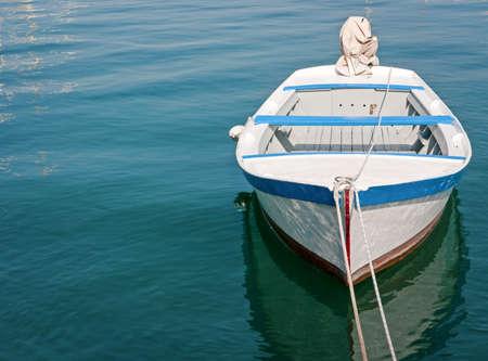 small boat: old wooden rowboat at a lake