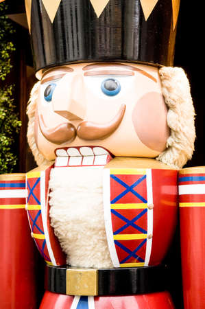 Typical Nutcracker wooden figure, which breaks the nuts using lever technology in its &quot,mouth &quot,. photo