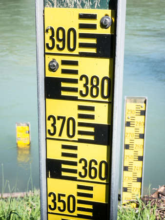 water level indicators at a river near hamburg photo
