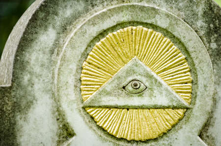 the everything seeing eye at a historic tombstone in munich
