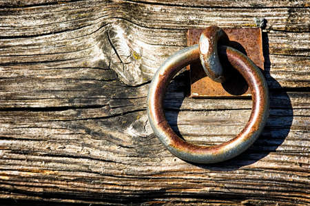 doorknocker: old loop at a harbor