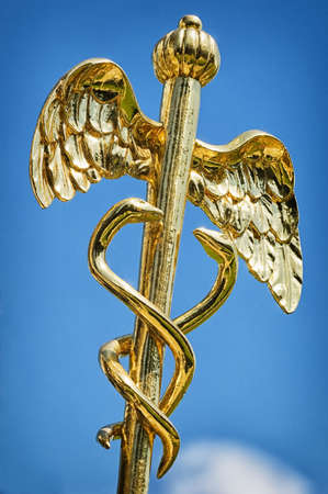 Caduceus - aesculap staff (sign for medicine) photo