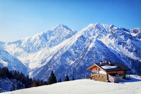 winter scenery: old house at the european alps in winter Stock Photo