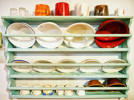 old wooden rack with dishware photo