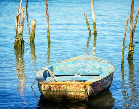 old wooden rowboat at a lake photo
