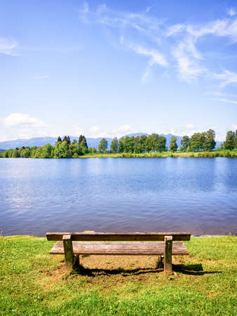 old wooden bench at a lake photo