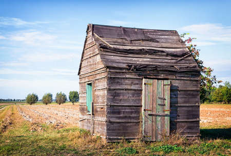 old building facade: old hut at a field Stock Photo