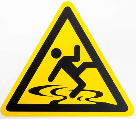 warning symbol: caution wet floor sign at a sidewalk