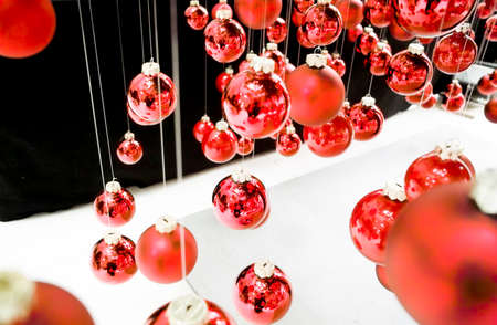 hanging christmas baubles at a christmas tree photo