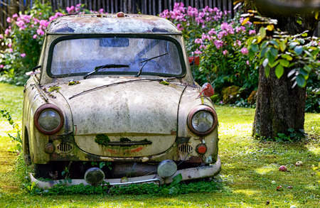 an old trabant at a garden photo