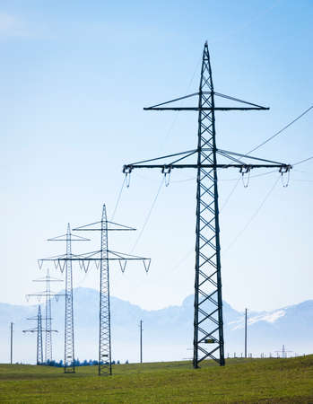 electricity pylons in front of blue sky photo