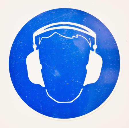 protectors: ear protectors sign at a construction site Stock Photo