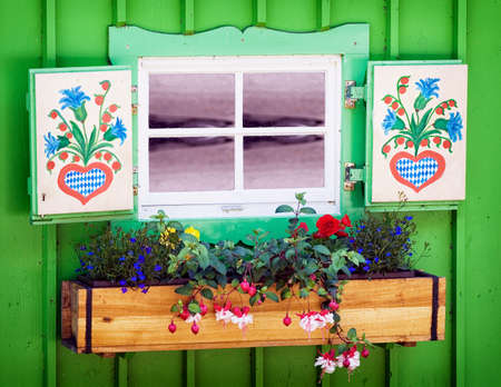old bavarian window with flowers Stock Photo
