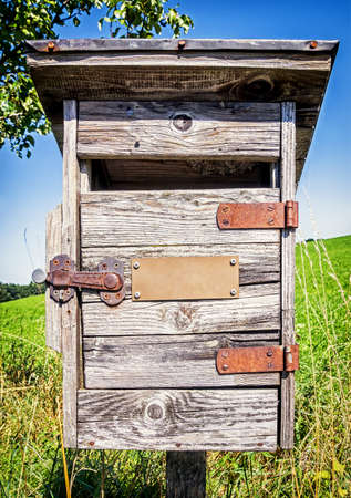 beautiful old letterbox at a meadow photo