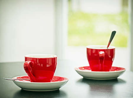 red cup: two espresso cups at a cafe