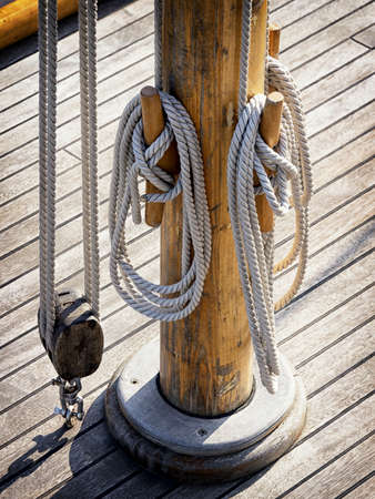 snatch: old snatch pulley at a sailboat